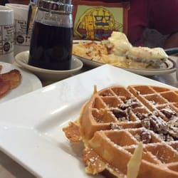 ... IL, United States. Pecan waffles, crispy bacon, southern eggs Benedict