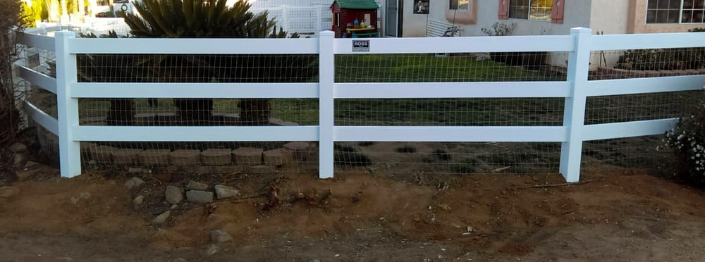 White 3-Rail Vinyl fence with non-climb wire attached on back side ...