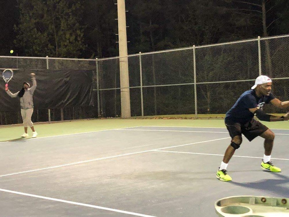 Photo of Tennis Lessons By McClain - San Francisco, CA, United States. My big brother and his wife playing doubles in NC