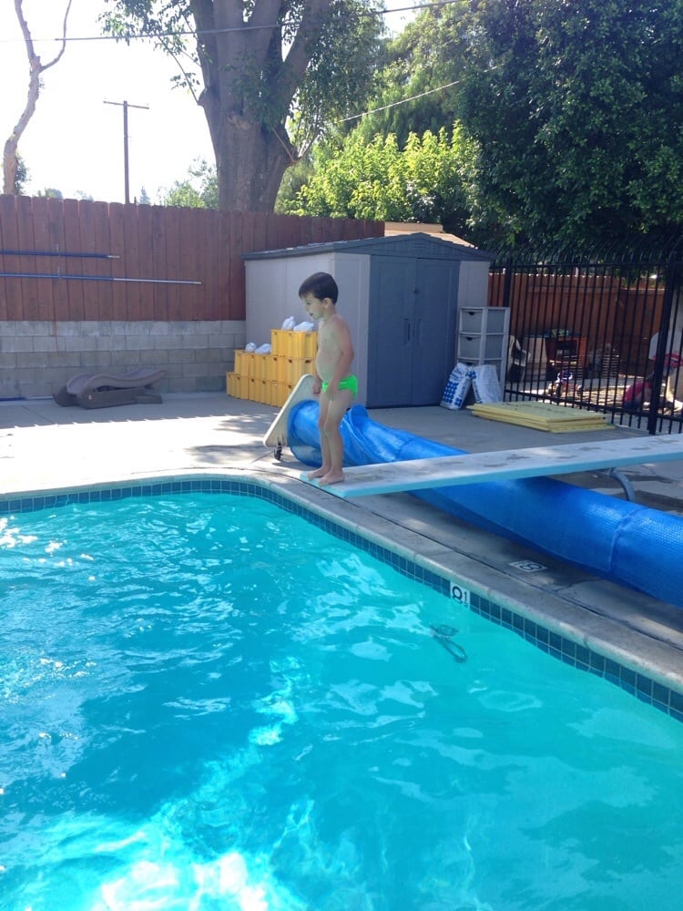 At the age of 2 learning to jump off the diving board & swim ...