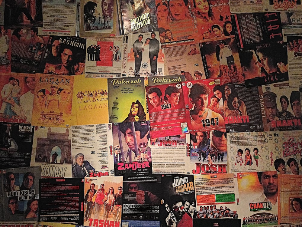 Wall of Bollywood DVD jackets in the back Yelp
