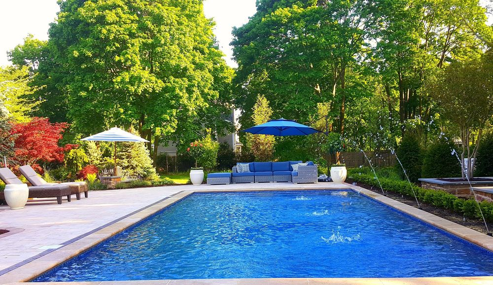 Pool patio design and landscaping long island yelp for Pool design long island
