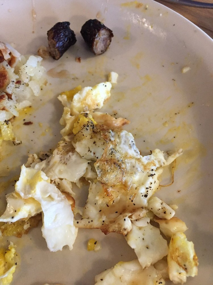 Sucked burned sausage over cooked eggs Terrible servers