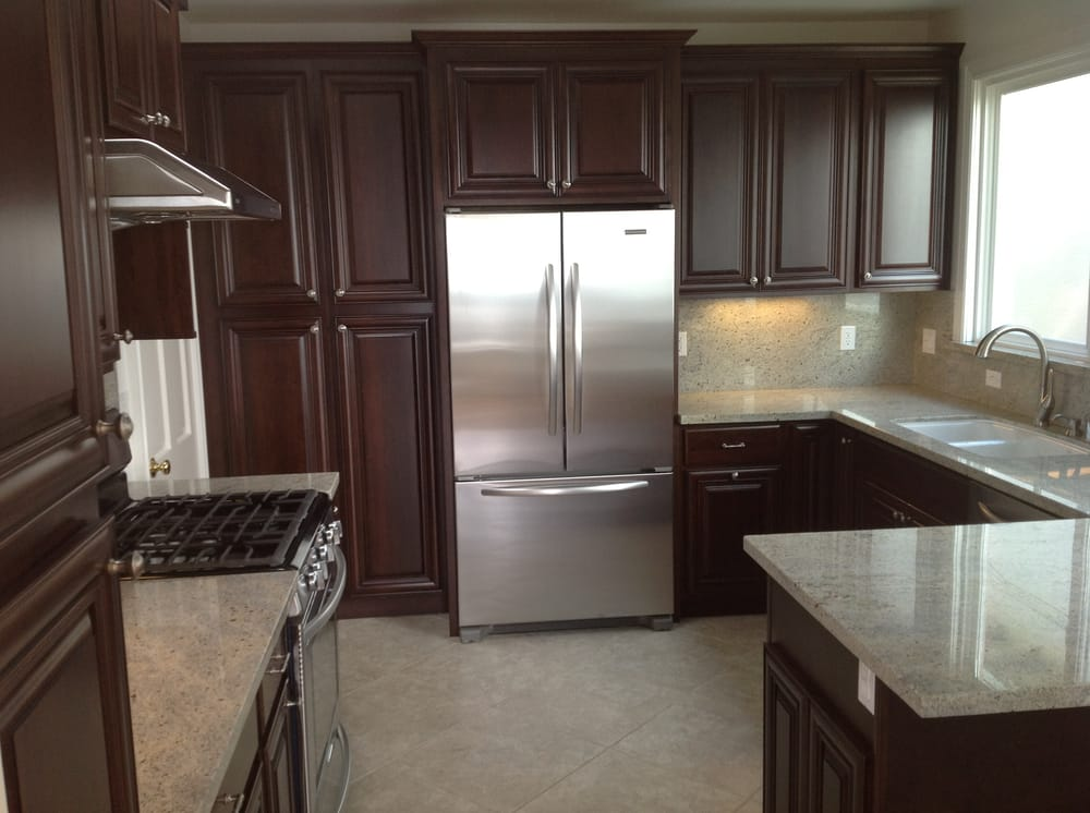 Chocolate Raised Panel w/ Kashmir White Granite Counter - Yelp