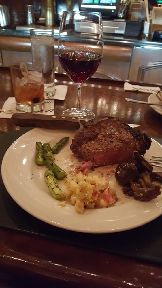 Bone-in Filet Mignon with Lobster Mac n cheese, Mushrooms and Asparagus. Washed down with a ...