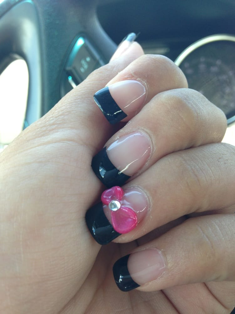 Gel fake nail with black French tip and a bow with rhinestone - Yelp