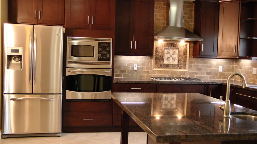 Shaker style cabinets in a espresso finish granite for Kitchen cabinets 90808