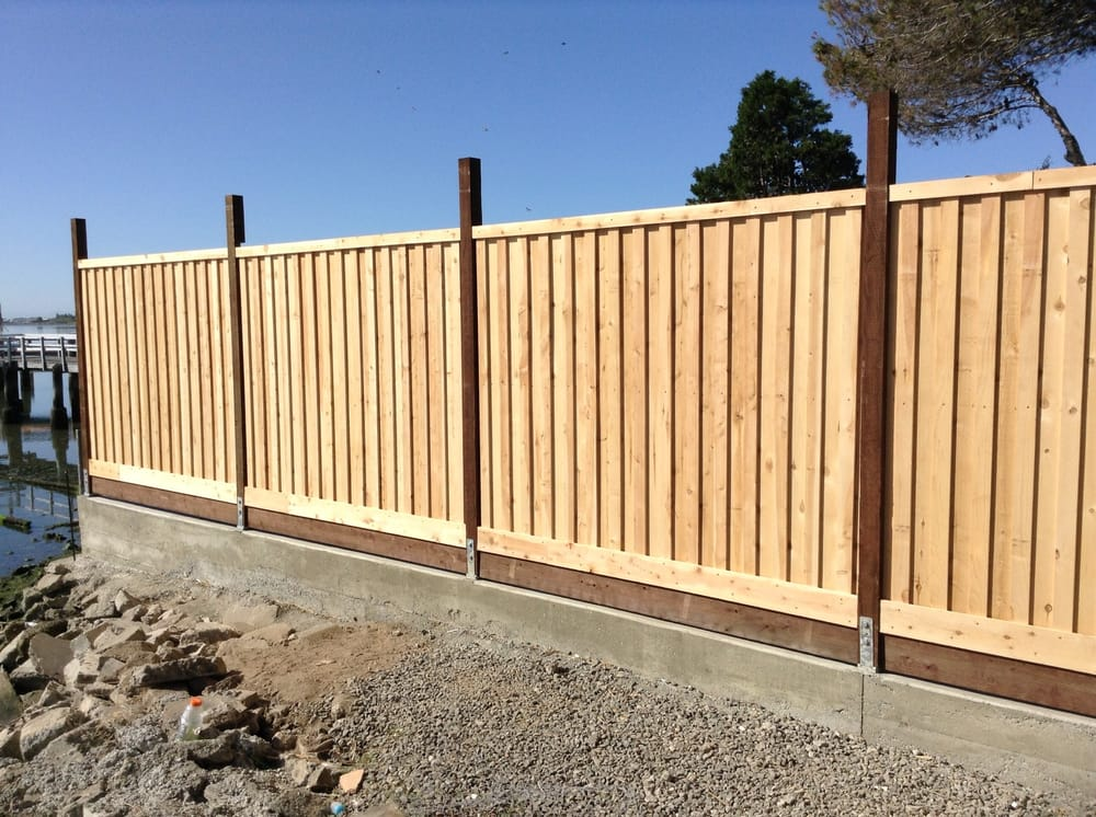 Fence build on small retaining wall - Yelp