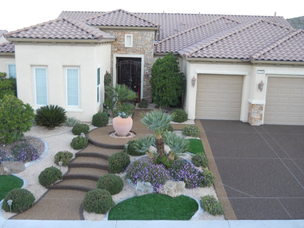 Pebble stone driveways and walkways make a statement to for Las vegas stone yards