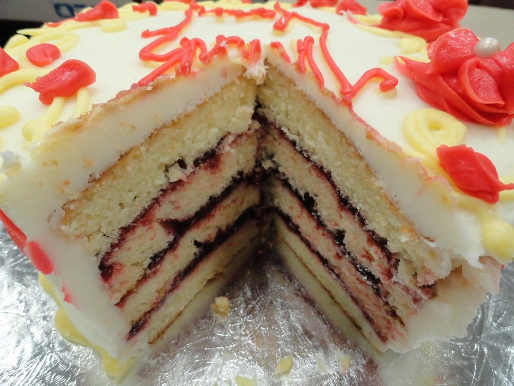 ... States. 8-inch, 4-layer, almond cake with raspberry filling (inside