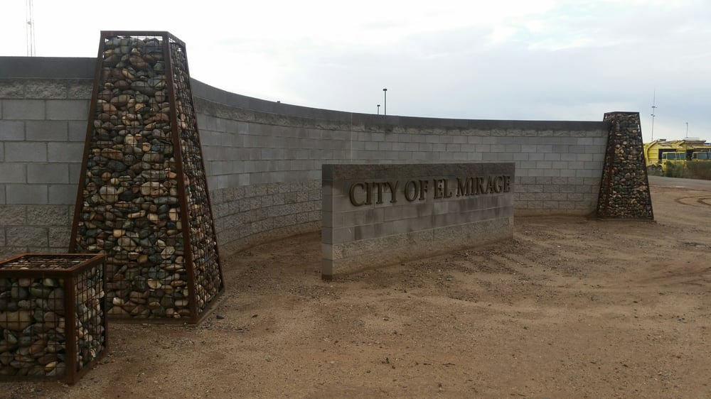 block walls with gabion baskets and a monument sign Yelp