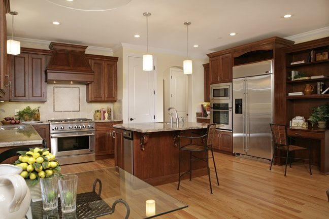 Kitchen With Cherry Cabinets, Granite Counter Tops And Red