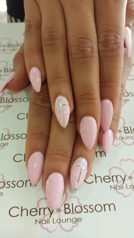 Baby pink stiletto nails with cross design - Yelp