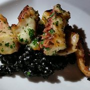 Photo of Valentino - Santa Monica, CA, United States. Grilled Octopus with Squid-Ink Couscous