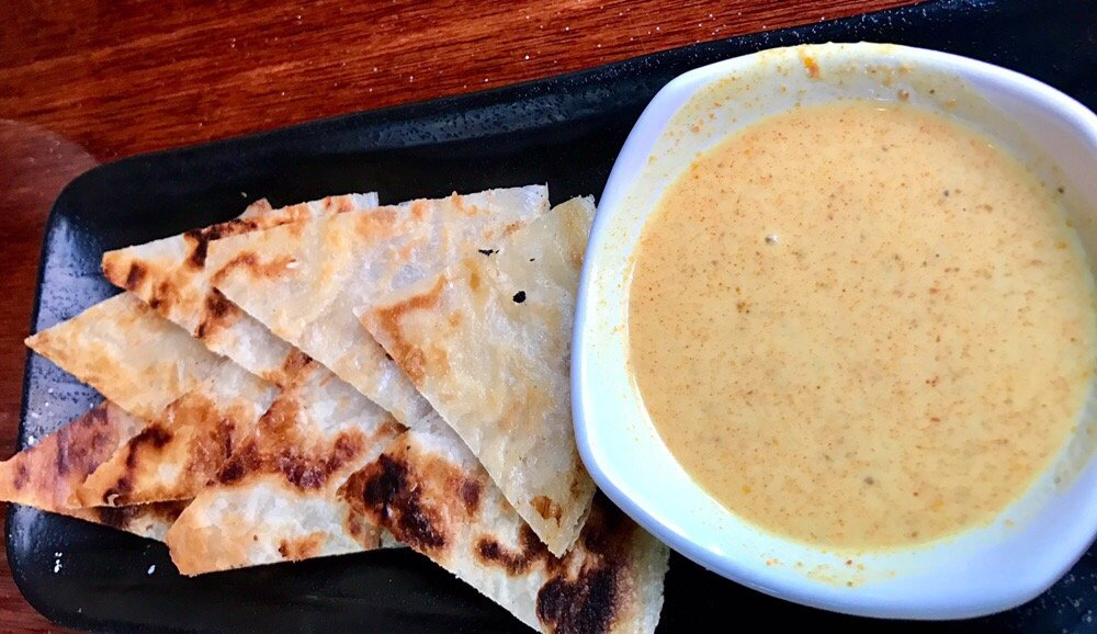 Roti appetizer good flavor curry dipping sauce but too for Roti food bar