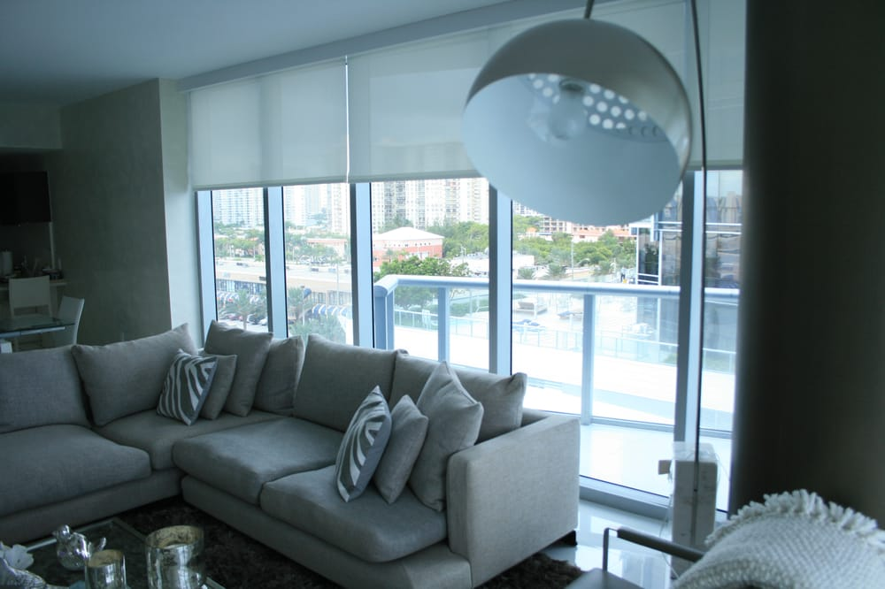 Motorized sheer roller shades and blackout shades in a for Motorized blackout roller shades