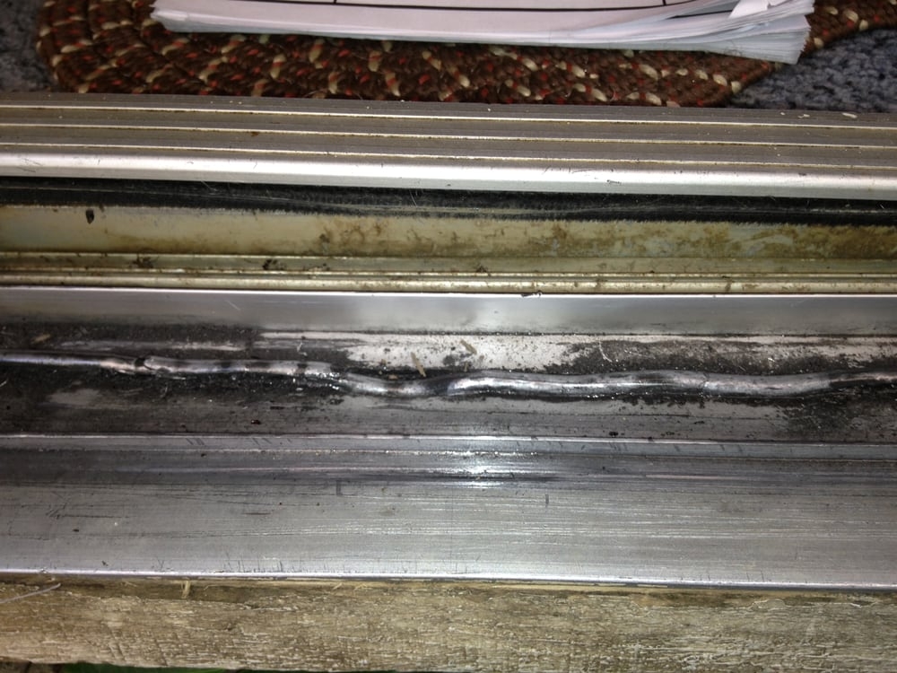 This Sliding Glass Door Track Is Damaged Beyond Repair And