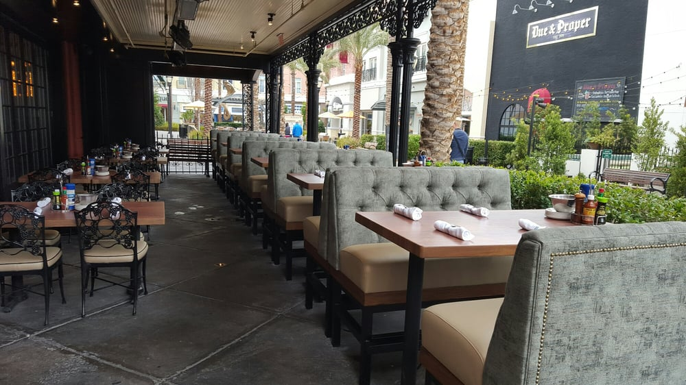 Updated outdoor seating area with new booths yelp for King fish house
