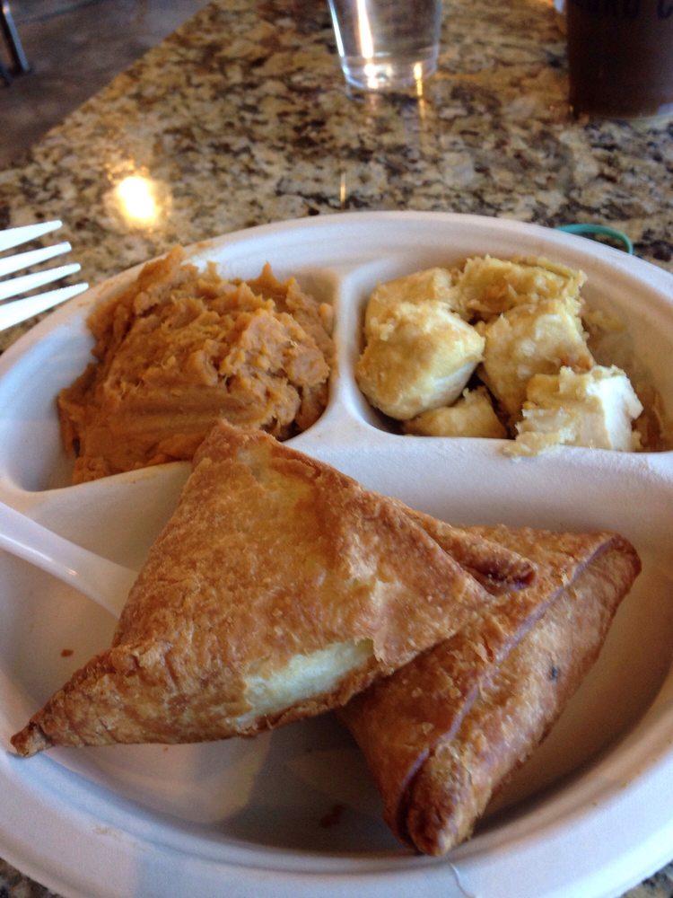 Chicken fried tofu, veggie samosa, and vegan mashed sweet