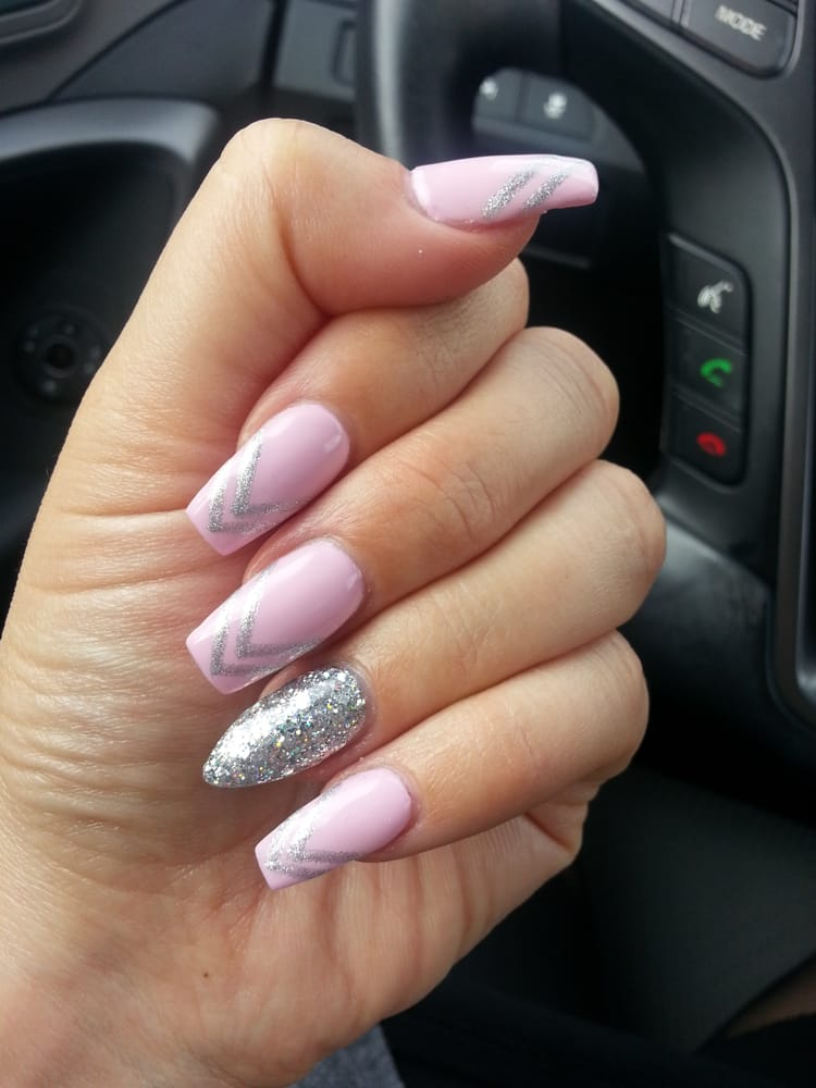 slight ballet flat pink nails with silver designs and a super ...