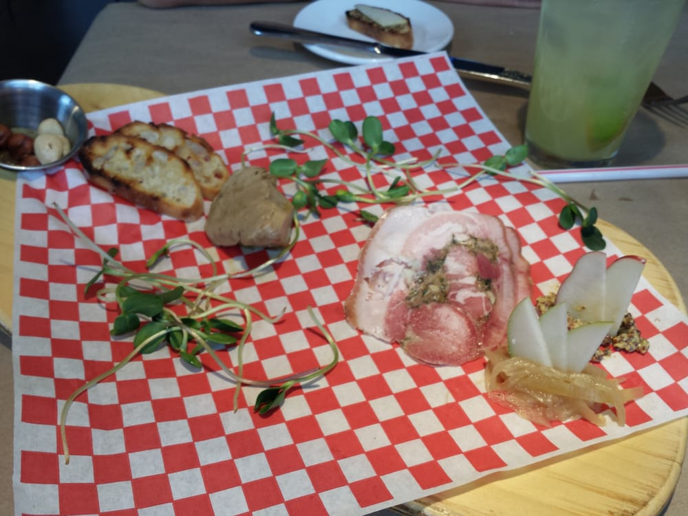 Charcuterie plate of house made porchetta and marinated for 707 foodbar grand junction