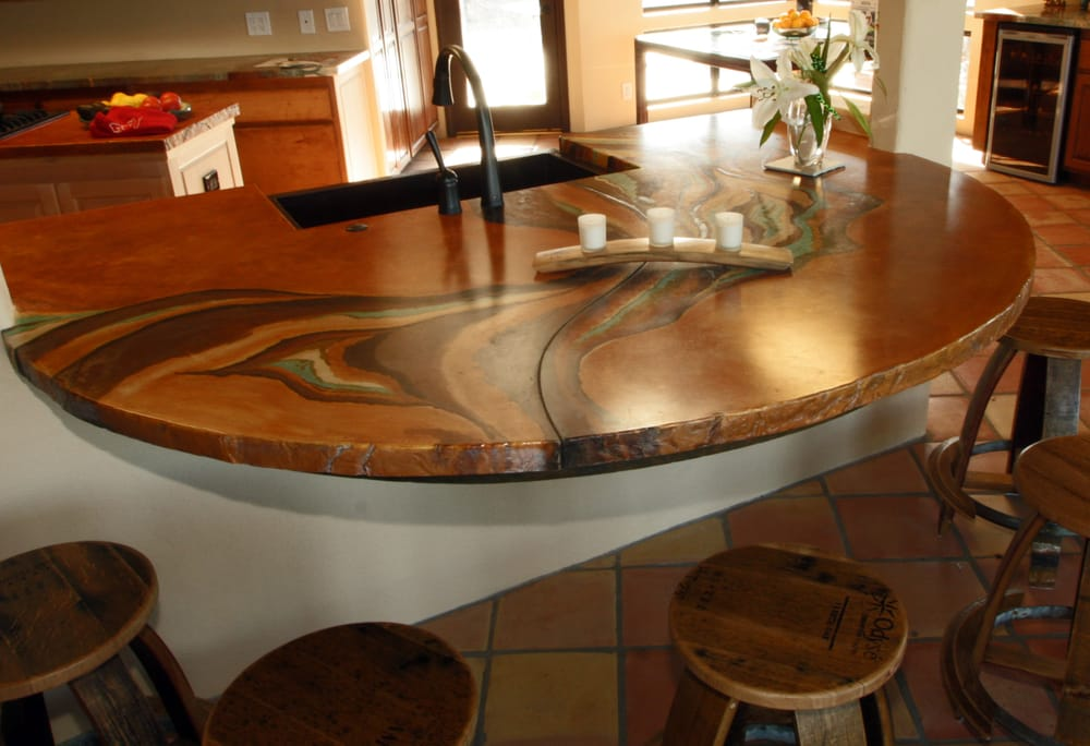 Cantilevered Custom Concrete Counter With Wine Barrel Bar