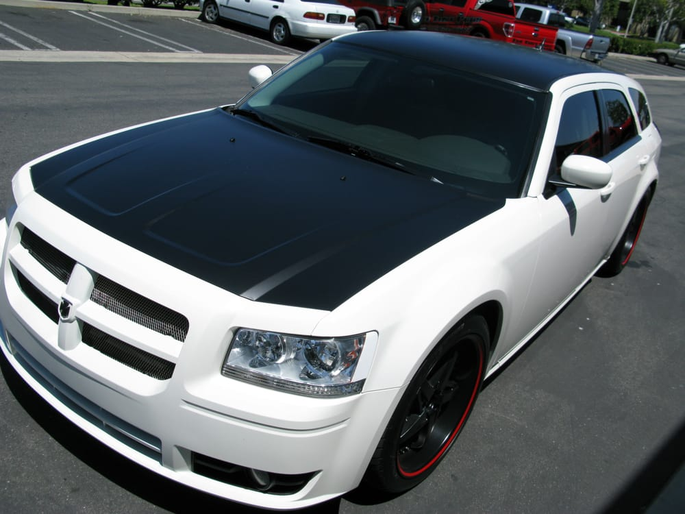 Dodge Magnum With Complete Tint And A Flat Black Rood And Hood Wrap
