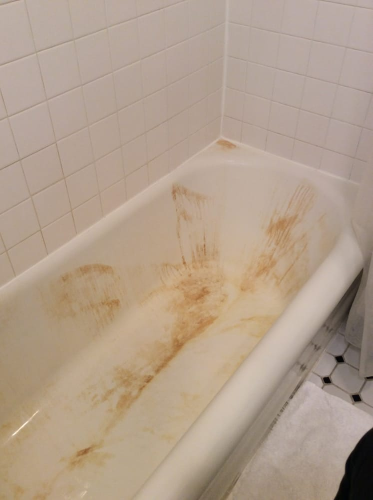 The cleaners used bleach on the bathtub resulting in a brown stain ...