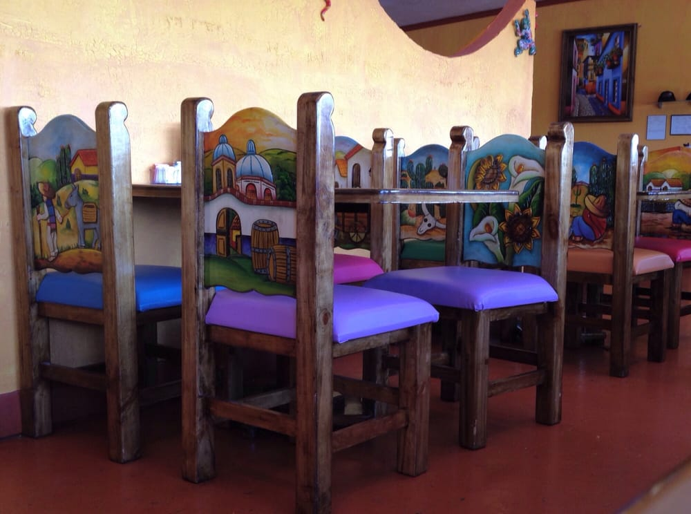 Photo of Agave Mexican Restaurant - Flagstaff AZ United States. Chairs are intricately & Chairs are intricately decorated heavy hardwood carved and painted ...