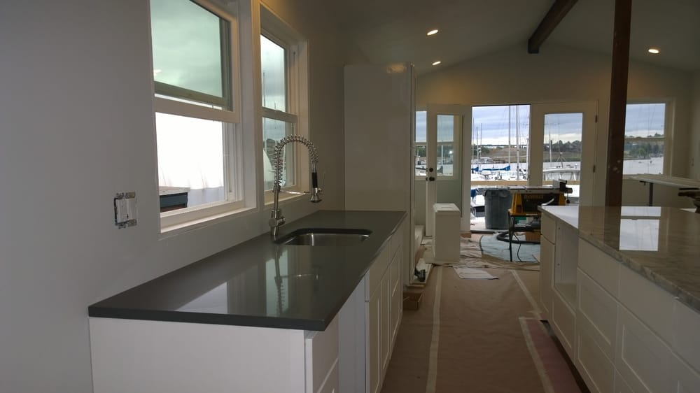 houseboat kitchen cabinets  quartz counter and sink from Kitchen and Bath Showroom Small Kitchens and Baths