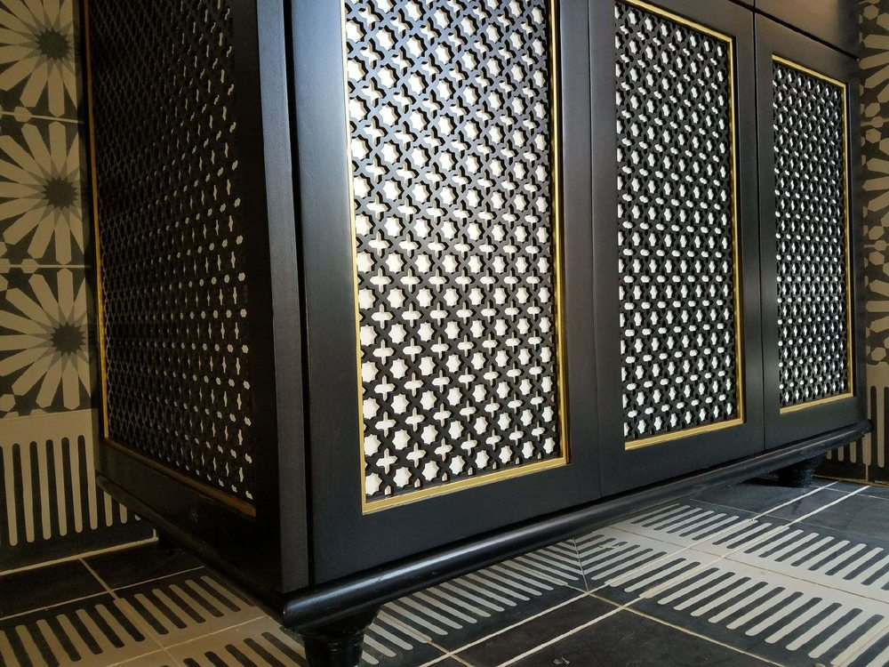 Custom designed laser cut panel for a cabinet installation  - Yelp