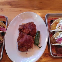 ... cured pork belly taco, flank steak taco, battered cod taco, and