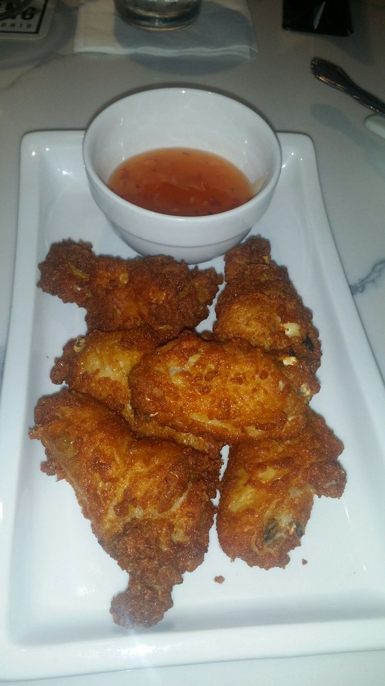 The Golden Wings Crispy And Juicy Served With Pineapple