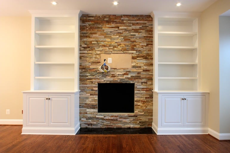 Custom Handcrafted Bookcases Encase This Stone Fireplace