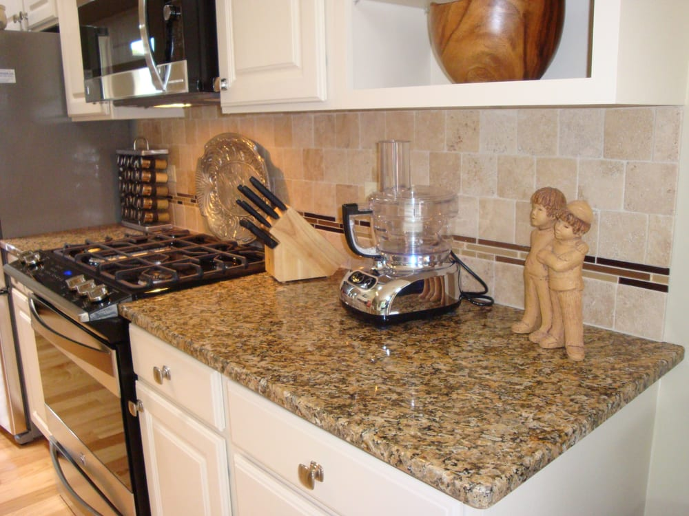 New Venetian Gold Granite With Travertine Tile Backsplash And Glass And Stone Mosaic Yelp