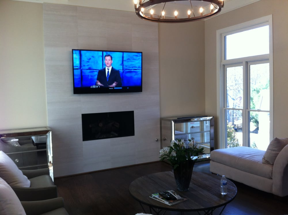 Tv Mounted Over A Marble Tile Fireplace Yelp