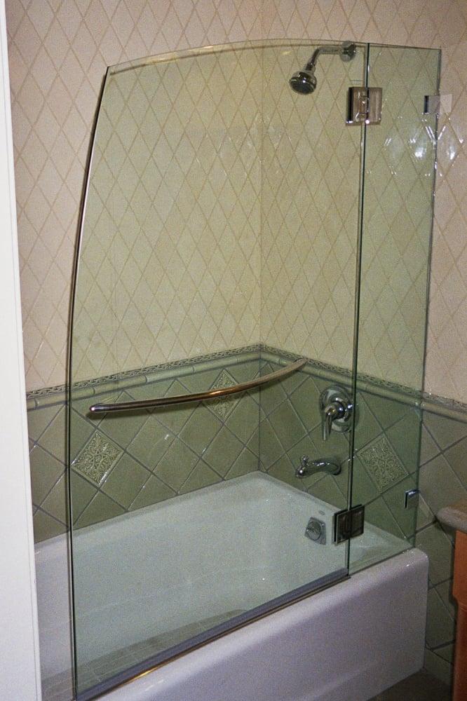 A Frameless Nautica Bath Screen With Stationary Panel On A