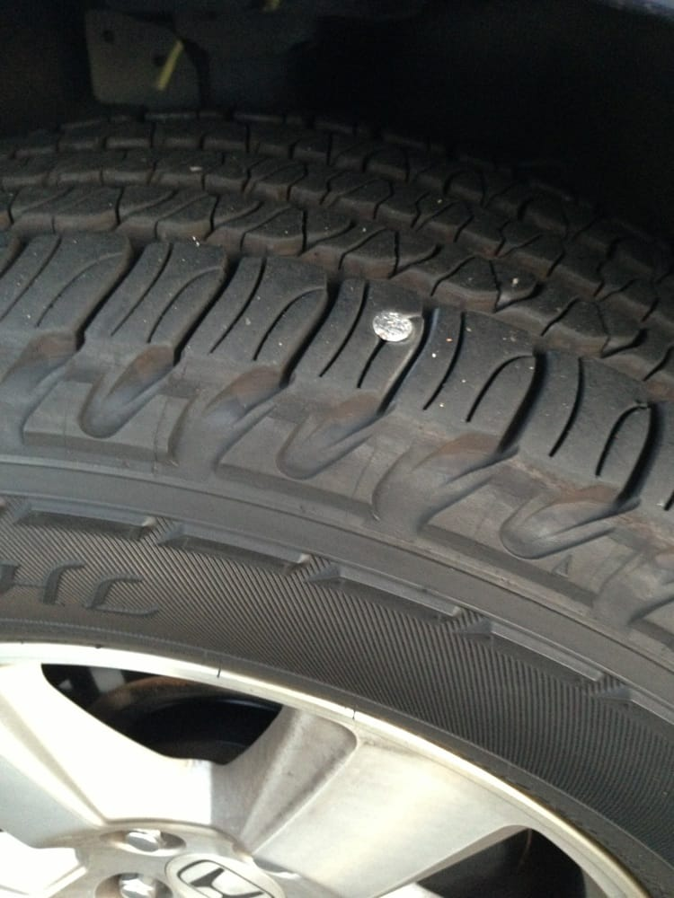 Nail in the tire but it wasn\'t big enough to puncture through! Pheww ...