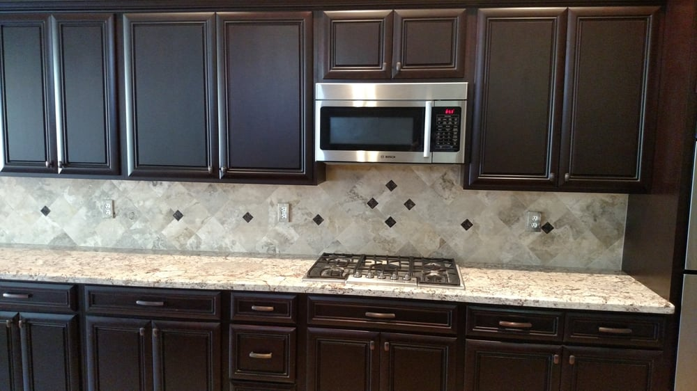 Cabinets Backsplash With Custom Granite Inserts And Granite From Granite Solutions Yelp