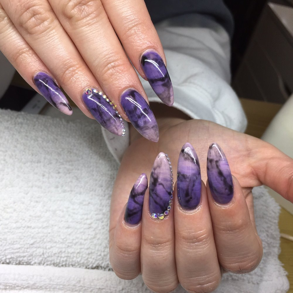 Stiletto nails with an ombré gel polish effect with marble nail art ...