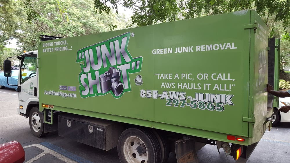 Uniformed Junk Shot employees showed up with this open-top boxcar ...