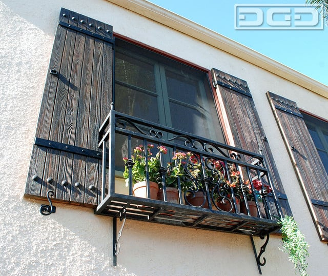 Spanish Colonial Style Shutters With Decorative Iron Hinge