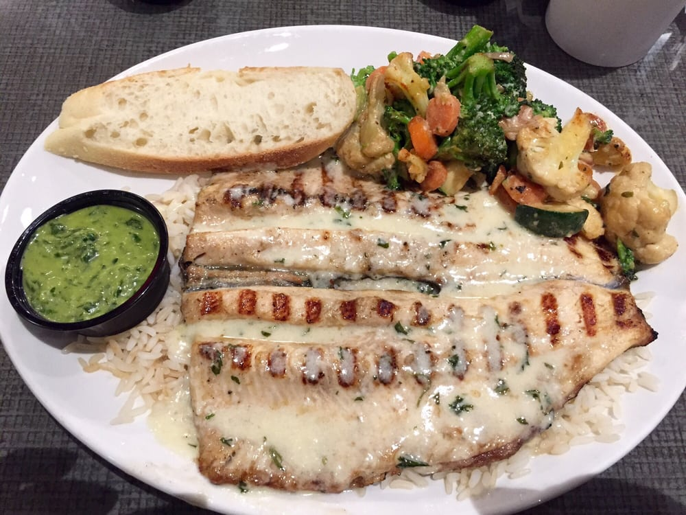 Delicious trout in garlic sauce with side of chimichurri for California fish grill