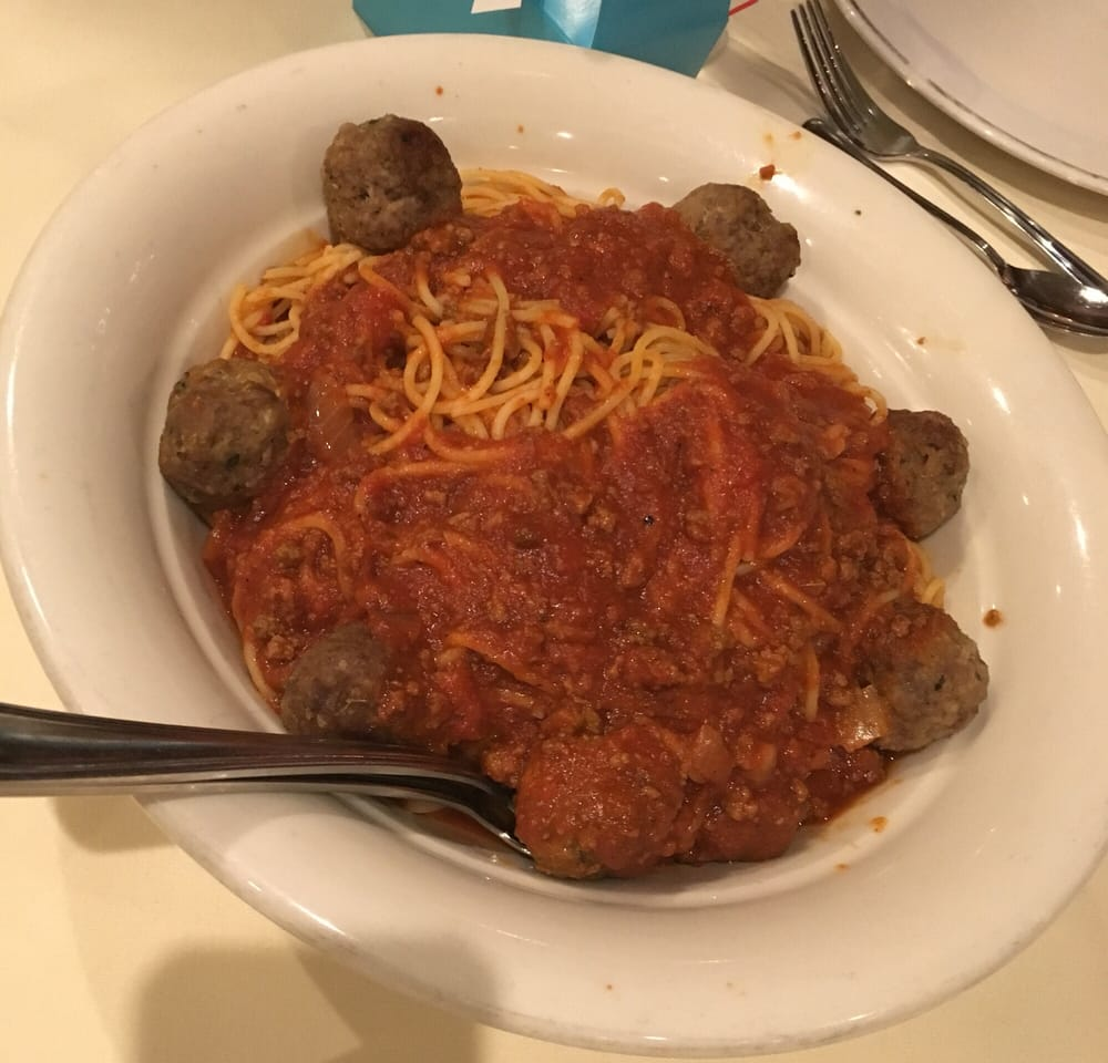 Photo of Maggiano's Little Italy - Skokie, IL, United States. Spaghetti with meat sauce and meatballs.