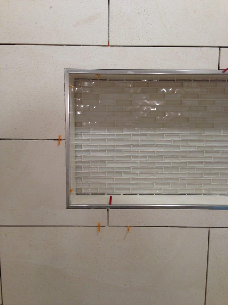 Look at the Schlutter trim he added around my shower niche. - Yelp