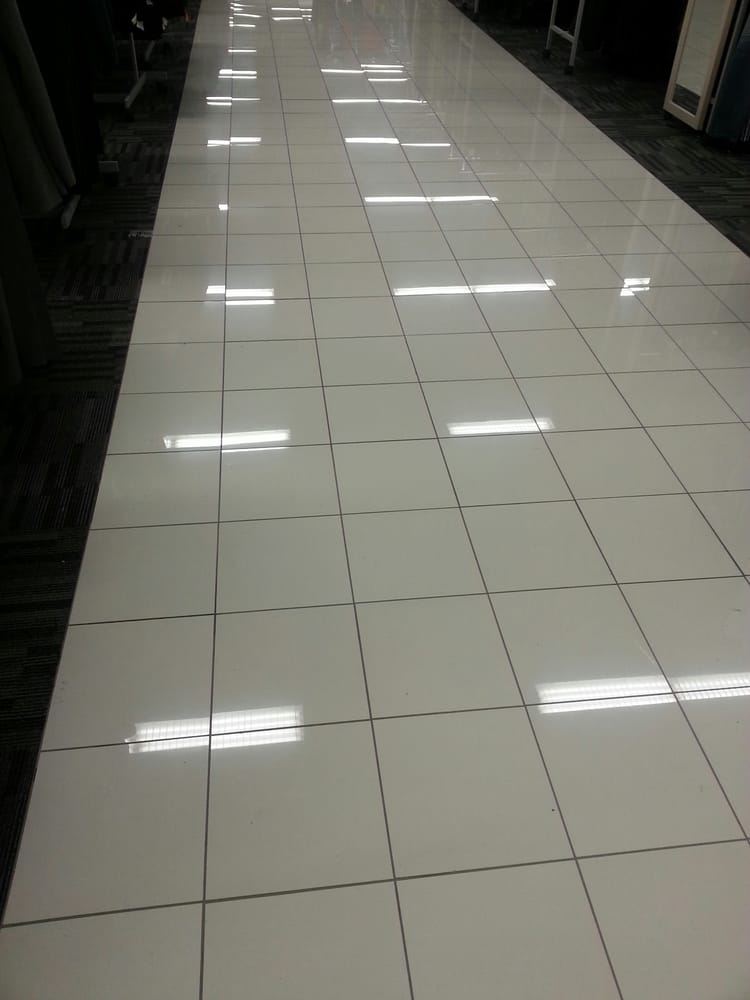 Nice, white, bright and shiny floor tiles lit up the newly remodeled ...