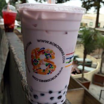 Taro milk tea with 50% sugar, lite ice, and added boba