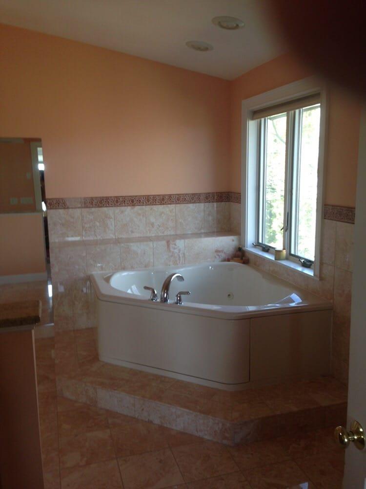 Corner tub on raised tile platform.Ceiling paint flat white and ...