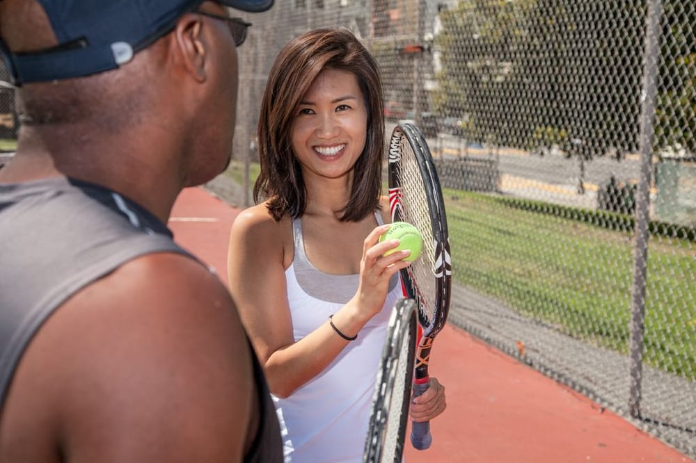 Photo of Tennis Lessons By Mcclain - San Francisco, CA, United States. Coach Mcclain conversing with a client Park Couture- custom shirts for men and women