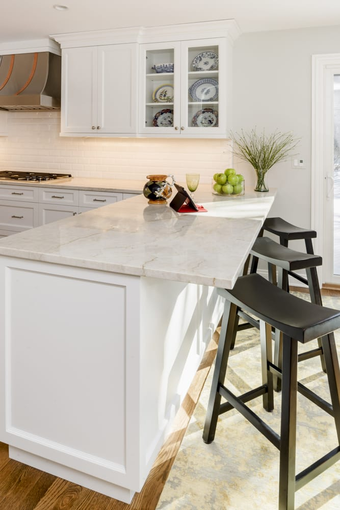 White transitional kitchen with perla venata taj mahal for Granite countertop overhang support requirements